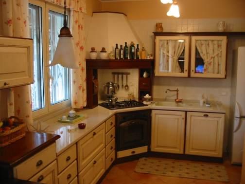 Arredamenti oscar bellotto – Cucina in taverna noce con piano snack